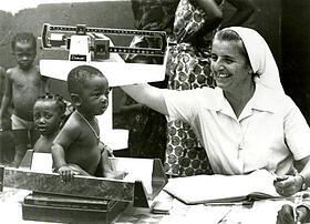 Benin, 1981 - Sr. Marot weighs children at a clinic in Benin. Photo from the CRS archives