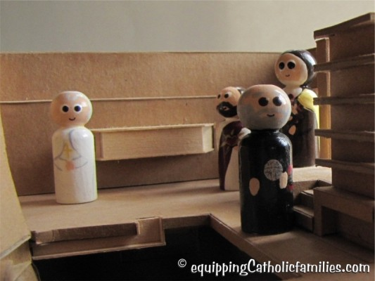 painted saints in a cardboard model