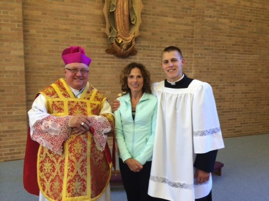 Bishop Robert Morlino, Kathi Klaas, and Phil Klaas in the oratory of the Diocese of Madison's Bishop O'Connor's Center