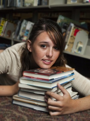 Teen at the Library by Arina Habich via Dollar Photo Club