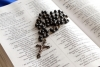 rosary-on-bible-1427670-s