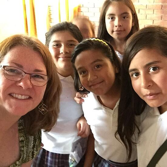 A selfie with the SILC students at St. Francis of Assisi Catholic School. Our CRS Rice Bowl gifts help support these students to learn about agriculture, savings and investments and also academic lessons that aid them and their families with real-world agricultural applications.
