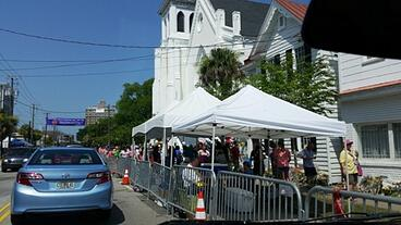 the number of people visiting the sidewalk memorial at Emanuel AME Church continues to grow.