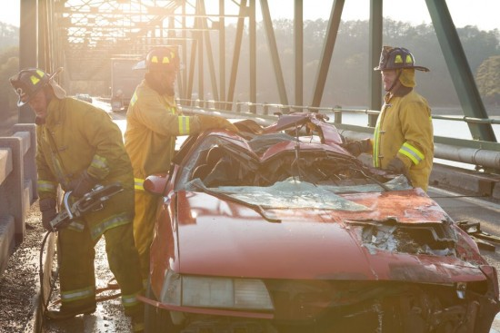 First responders work to extract Don from the mangled wreckage after he returns to life in 90 MINUTES IN HEAVEN, from Giving Films, LLC, releasing Sept. 11, 2015. (Photo credit: Quantrell Colbert) - Image used with permission