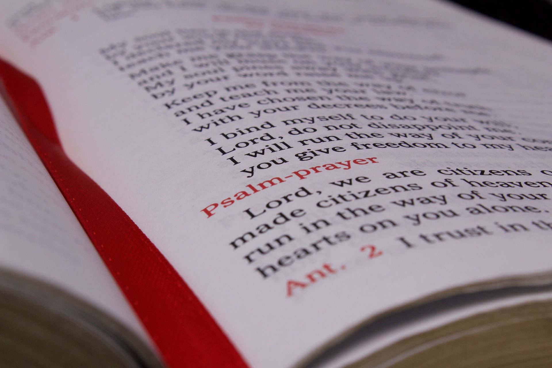 close-up of open breviary with red ribbon