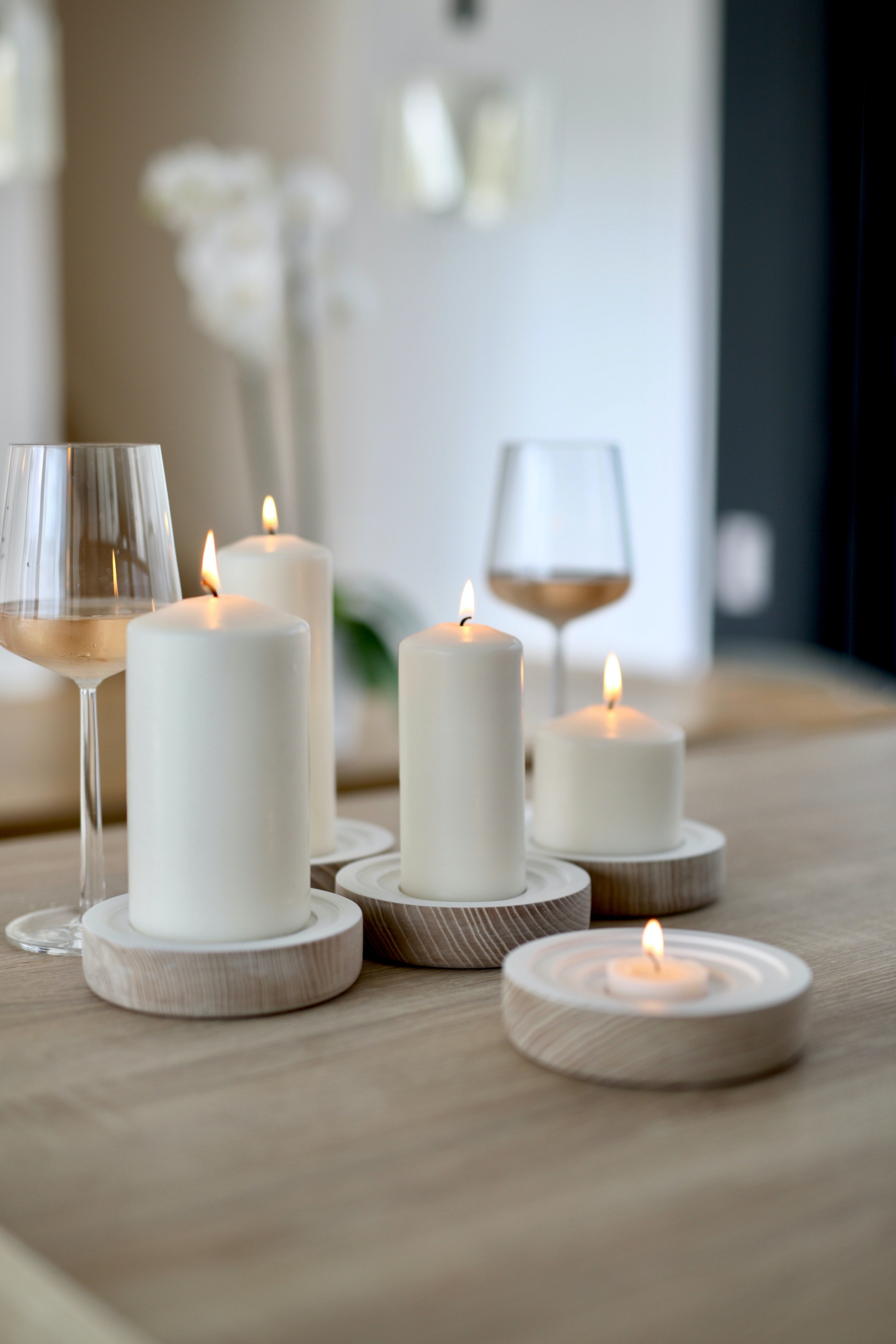 romantic table setting with wine glasses and candles